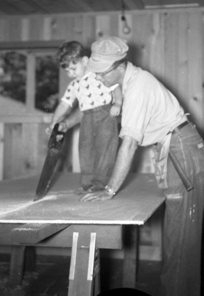 """The Carpenter:  Helping Dad build the addition onto 213 South Main Street.  It started out as a Broom Closet and ended up as a Living Room!  Mom always called it """"The $2,500.00 Broom Closet""""!"""