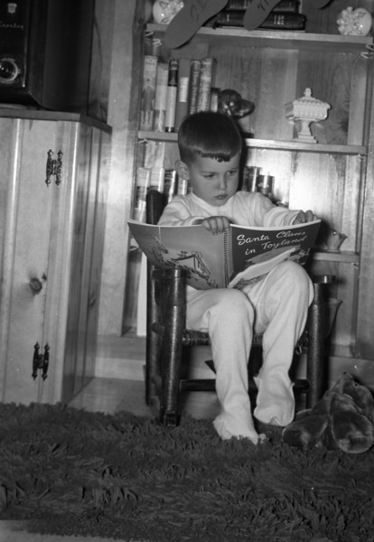 Here I am, sitting in my little rocking chair, reading some sort of Christmas book.