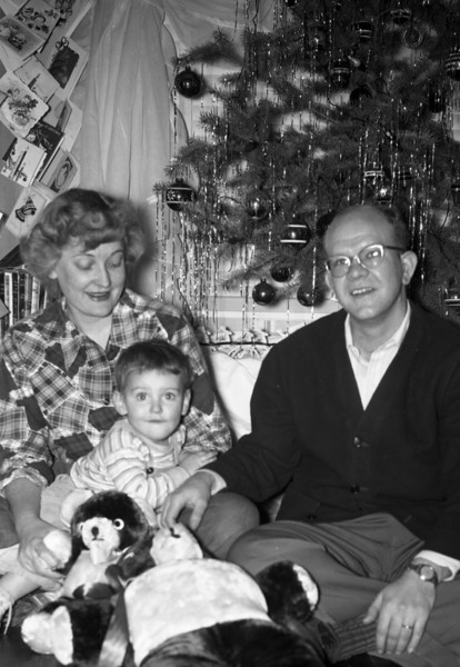 It's Christmas, probably my first, which would make it Christmas 1950.  Mom & Dad got me in November, 1950.  In the photo are two teddy bears.  The smaller of the two I still have!