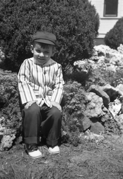 Here I am, sitting in Grandma Hindmarch's Rock Garden at 213 South Main Street.  The Rock Garden was split between 209 and 213 South Main Street.  It has been gone for many years now.  It is currently the paved parking lot of Tri-Township Library.