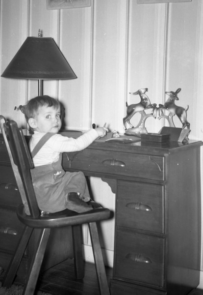 Here I am, sitting at Mom's desk in the old Living Room at 213 South Main Street.  The desk and chair are still in the family.  John has the desk, which was part of a Bedroom Set and he also has the Cushman Maple Kitchen Table with four Chairs.