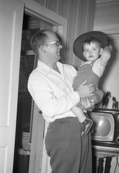 Dad is holding me in this photo.  This has to be late 1950 or early 1951.  Note the television behind us!