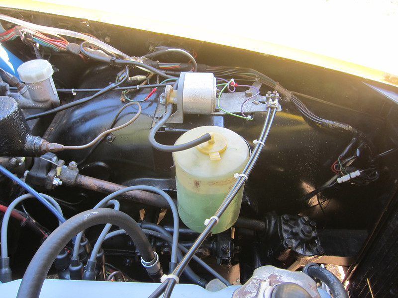 Windshield washer pump and reservoir.