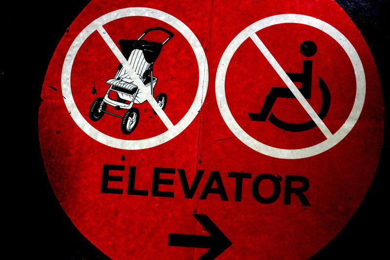 the wordsmith is often called to duty at the strangest times. (elevator sign)  light a little shed on the truth