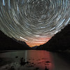 Star trails and aurora australis over Lake Howden