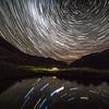 Star trails over campsite in Ellis Basin