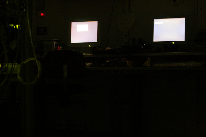 Control desk in the dark. Those screens are actually black - shows how black the black is on a cheap LCD