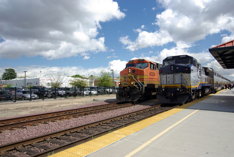 The Freight train pulls up along side the Amtrak Commuter Train, Fresno CA
