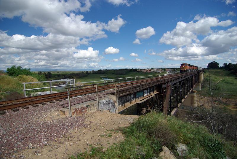 A BNSF Freight Train Crosses the San Joquin River Bridge (2)