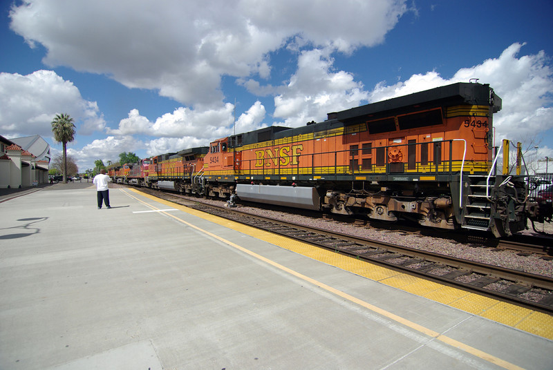 The enormous Freight Train pulls out from the Amtrak Station in Fresno CA (2)