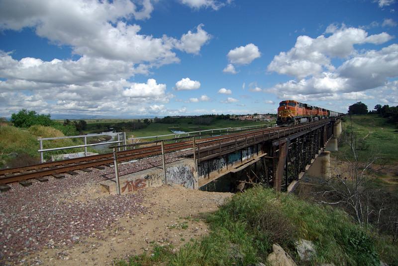 A BNSF Freight Train Crosses the San Joquin River Bridge (3) JPG