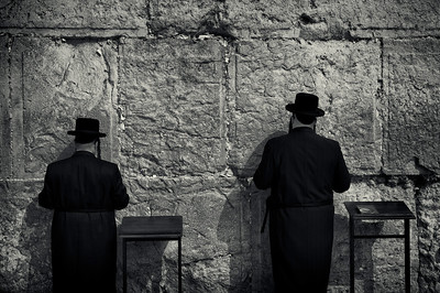 The Western Wall, Wailing Wall or Kotel (Hebrew:  הַכֹּתֶל הַמַּעֲרָבִי, is located in the Old City of Jerusalem at the foot of the western side of the Temple Mount. It is a remnant of the ancient wall that surrounded the Jewish Temple's courtyard, and is one of the most sacred sites in Judaism outside of the Temple Mount itself. Just over half the wall, including its 17 courses located below street level, dates from the end of the Second Temple period, commonly believed to have been constructed around 19 BCE by Herod the Great.