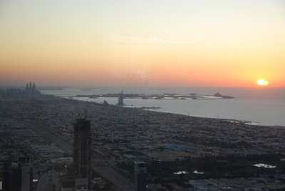 Sunset, the Burj al Arab, the Palm and the marina area in the distance.