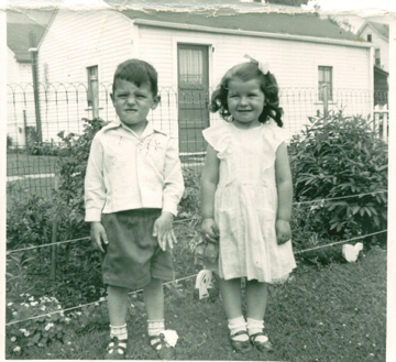 Me, with my aunt Maxine in my grandfather's back yard.