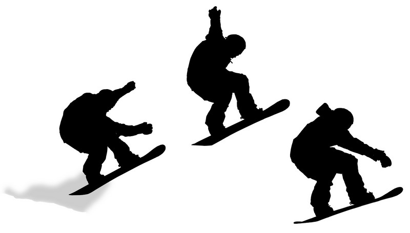 A jump silhouette sequence with a snowboarder in mid-air. This starts with the intial jump with a spray of snow trailing behind, the peak and then just about to land. The profiles are left in black and white as a series of cut-outs.