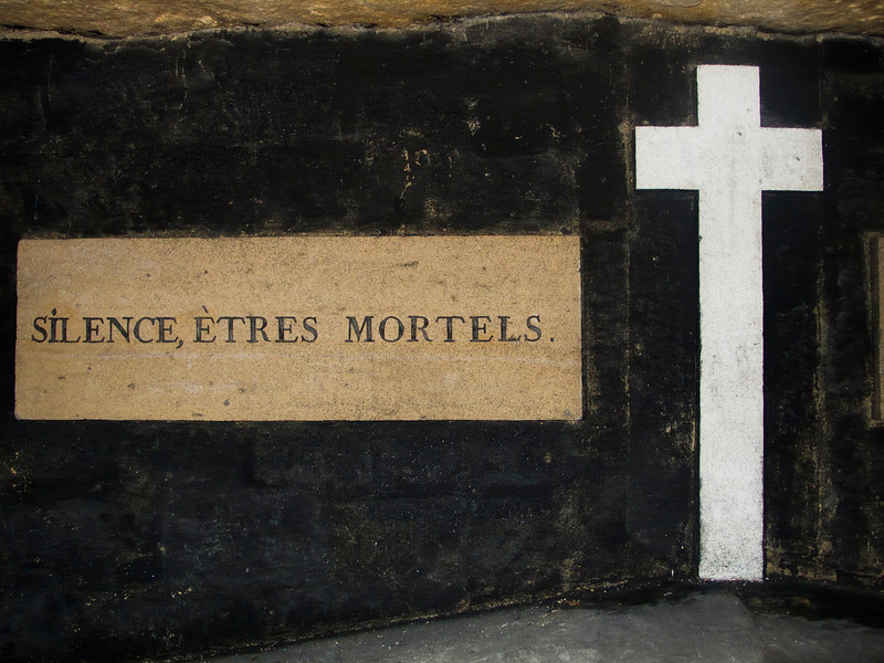 Silence, Etres Mortels (or Silence, Mortal Beings) is a warning sign in the catacombs under Paris where millions of skeletons are buried.