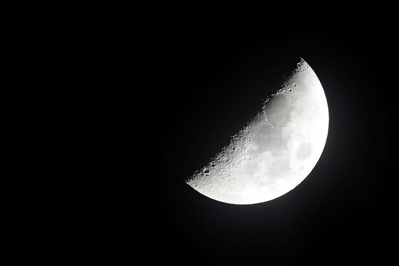 The Breath<br /> <br /> A March evening<br /> standing outside and watching<br /> the half moon on it's side<br /> between the silhouette of tall trees<br /> thin clouds racing past<br /> revealing the stars<br /> that hang above the house<br /> if I tilt my head and exhale<br /> the breath rises up to <br /> mimic the wisps of clouds<br /> blending together<br /> in the night<br /> <br /> Jill Fitz 2014