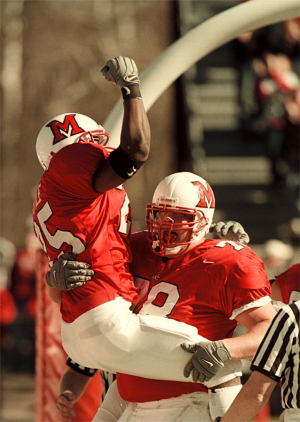 E.L. Hubbard/Journal-News<br /> Miami's Steve Little is hoisted up by Joe Costello after Little scored a touchdown in the first quarter of their game against Marshall Saturday at Yager Stadium.