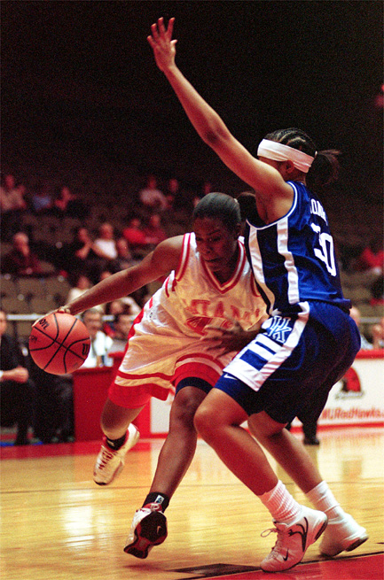 E.L. Hubbard/Journal-News<br /> Miami's forward Kim Lancaster tries to get past University of Kentucky's forward Shambrica Jones earlyin the first half of their game Wednesday night in Oxford at Millett Hall.   Lancaster was forced to pass to a teammate as Jones stopped her penetration.