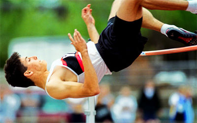 "Lakota East's Erik Reynolds clears the high jump at 6'4"". on his way to eventually clear 6'8"" at win the district Monday at Fairfield's track.<br /> e.l. hubbard foto"