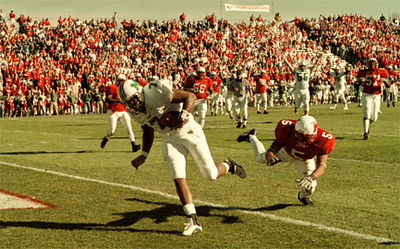 E.L. Hubbard/Journal-News<br /> Marshall's quarterback gets into the end zone after catching a pass from teammate Brandon Carey and eluding Miami's Rod Clark in the third quarter Saturday at Yager Stadium.