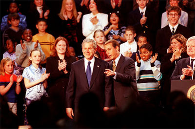 E.L. Hubbard/Journal-News<br /> President George Bush and U.S. Rep. John Boehner scan the crowd at Hamilton High School after Bush's arrival to sign the education bill.