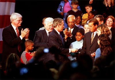 E.L. Hubbard/Journal-News<br /> President George Bush hands a pen used to sign the education bill to U.S. Rep. John Boehner.  From left to right standing are Rep. George Miller, D-Calif., Sen. Edward Kennedy, D-Mass., and Education Secretary Rod Paige. Woman at right unidentified. Children with Bush are Tez Taylor, left, and Cecilia Pallcio, right.