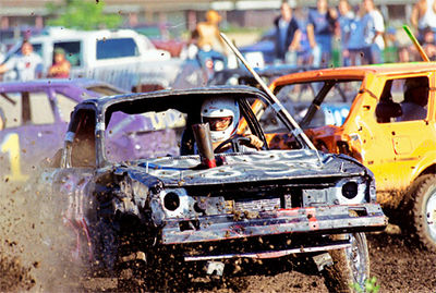Mud and debris fly as Saturday night's demolition derby gets under way at the Butler County Fairgrounds.  The derby featured several class of cars, and a duel between Hamilton vice-mayor Tom Nye and Butler County Chief Deputy Rick Jones.<br /> E.L. Hubbard/Journal-News