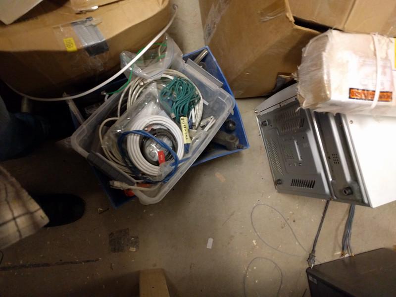 Blue bin of ??? and plastic bin of ??