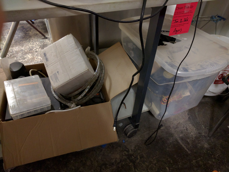 Boxes of crap under electronics bench