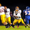 Don Knight/The Herald Bulletin<br /> Alexandria's Bryan Carter takes the hand off from quarterback Blaize Kelly as the Tigers faced the Elwood Panthers in the sectional semi-final on Friday.