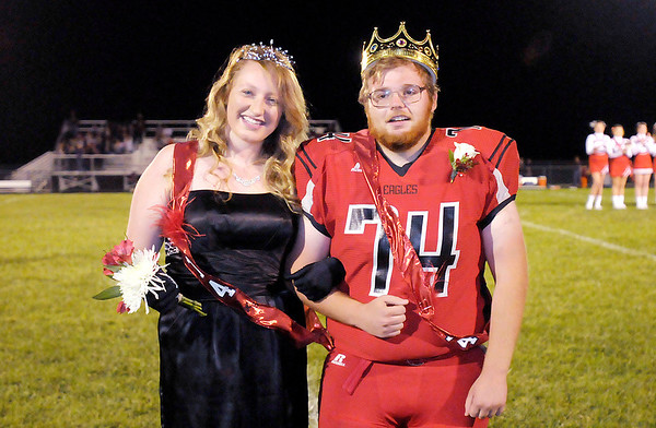 Don Knight/The Herald Bulletin<br /> From left, Taylor Creech and Griffin Eldridge were crowned as Frankton's Homecoming Queen and King at halftime of the Eagles game against the Alexandria Tigers on Friday.