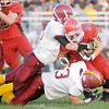 Don Knight/The Herald Bulletin<br /> Alexandria's Evan Hodges and Jacob Thurston tackle Frankton's Colton Waymire on Friday.