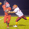 Don Knight/The Herald Bulletin<br /> Alexandria's Isaac Walker sacks Frankton quarterback Brayden Ginder on Friday.