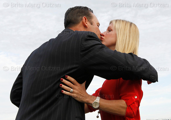 FORT MYERS, FL, Feb. 17, 2012: Boston Red Sox pitcher Tim Wakefield gets a kiss from wife Stacy after announcing his retirement from baseball after 19 Major League seasons, the last 17 with the Red Sox. (Brita Meng Outzen/Boston Red Sox)