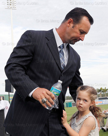 FORT MYERS, FL, Feb. 17, 2012: Boston Red Sox pitcher Tim Wakefield hugs his daughter Brianna, 7, after officially announcing his retirement from baseball after 19 Major League seasons, the last 17 with the Red Sox. (Brita Meng Outzen/Boston Red Sox)