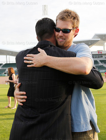 FORT MYERS, FL, Feb. 17, 2012: Boston Red Sox pitcher Tim Wakefield, left, gets a hug from pitcher Daniel Bard after announcing his retirement from baseball after 19 Major League seasons, the last 17 with the Red Sox. (Brita Meng Outzen/Boston Red Sox)
