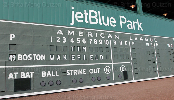 FORT MYERS, FL, Feb. 17, 2012: The manual scoreboard on the Green Monster at JetBlue Park at Fenway South pays tribute to Boston Red Sox pitcher Tim Wakefield, who announced his retirement from baseball after 19 Major League seasons, the last 17 with the Red Sox. (Brita Meng Outzen/Boston Red Sox)