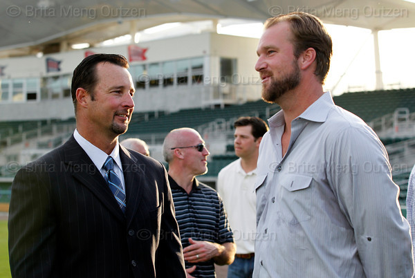 FORT MYERS, FL, Feb. 17, 2012: Boston Red Sox pitcher Tim Wakefield, left, talks with current Cleveland Indians pitcher Derek Lowe, a teammate on the 2004 World Championship Red Sox, after announcing his retirement from baseball after 19 Major League seasons. (Brita Meng Outzen/Boston Red Sox)