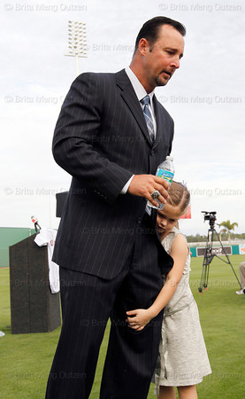FORT MYERS, FL, Feb. 17, 2012: Boston Red Sox pitcher Tim Wakefield is hugged by his daughter Brianna, 7, after officially announcing his retirement from baseball after 19 Major League seasons, the last 17 with the Red Sox. (Brita Meng Outzen/Boston Red Sox)