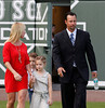 FORT MYERS, FL, Feb. 17, 2012: Boston Red Sox pitcher Tim Wakefield, right, and his family, from left, wife Stacy, son Trevor, 6, and daughter Brianna, 7 walk onto the field at JetBlue Park at Fenway South for Wakefield's retirement announcement. (Brita Meng Outzen/Boston Red Sox)