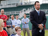 FORT MYERS, FL, Feb. 17, 2012: Boston Red Sox pitcher Tim Wakefield, right, tries to contain his emotions next to wife Stacy, left, and son Trevor, 6, before announcing his retirement from baseball after 19 Major League seasons, the last 17 with the Red Sox. (Brita Meng Outzen/Boston Red Sox)