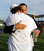 FORT MYERS, FL, Feb. 17, 2012: Boston Red Sox pitcher Tim Wakefield, right, and catcher Jarrod Saltalamacchia hug after  Wakefield's retirement announcement. (Brita Meng Outzen/Boston Red Sox)