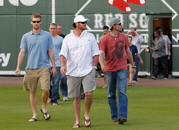 FORT MYERS, FL, Feb. 17, 2012: Led by Boston Red Sox catcher Jarrod Saltalamacchia, center, Red Sox players, from left, Daniel Bard, Michael Bowden, Scott Atchison, Josh Beckett, Clay Buchholz and Jon Lester walk onto the field to support teammate Tim Wakefield during his retirement announcement. (Brita Meng Outzen/Boston Red Sox)