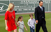 FORT MYERS, FL, Feb. 17, 2012: Boston Red Sox pitcher Tim Wakefield, right, and his family, from left, wife Stacy, daughter Brianna, 7, and son Trevor, 6, walk onto the field at JetBlue Park at Fenway South for Wakefield's retirement announcement. (Brita Meng Outzen/Boston Red Sox)
