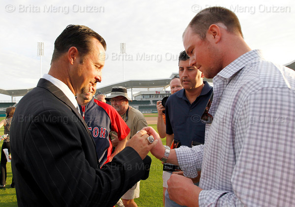 FORT MYERS, FL, Feb. 17, 2012: Boston Red Sox pitcher Tim Wakefield, left, receives a special set of golf balls from teammate Jon Lester, right, and Pawtucket pitching coach Rich Sauveur, second from right, after announcing his retirement from baseball after 19 Major League seasons, the last 17 with the Red Sox. (Brita Meng Outzen/Boston Red Sox)
