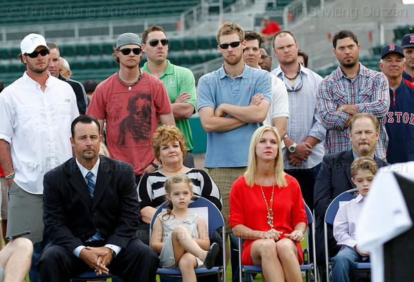 FORT MYERS, FL, Feb. 17, 2012: Boston Red Sox pitcher Tim Wakefield, front left, sits next to his daughter Brianna, 7, wife Stacy and son Trevor, 6, in front of teammates, from left, Jarrod Saltalamacchia, Scott Atchison, Clay Buchholz, John Lackey, Daniel Bard, Rich Hill John Lester, Josh Beckett and Red Sox manager Bobby Valentine as Red Sox chairman Tom Werner speaks during Wakefield's retirement announcement. (Brita Meng Outzen/Boston Red Sox)