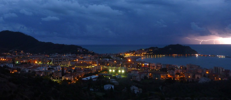 While I was shooting my time-lapse from the Mimosa hill I took by chance this photo of the Sestri Levante's peninsula enlightened by lightning. I was also a bit concerned, but the storm was quite distant from my position. 80 ISO, exposure time 1 second.