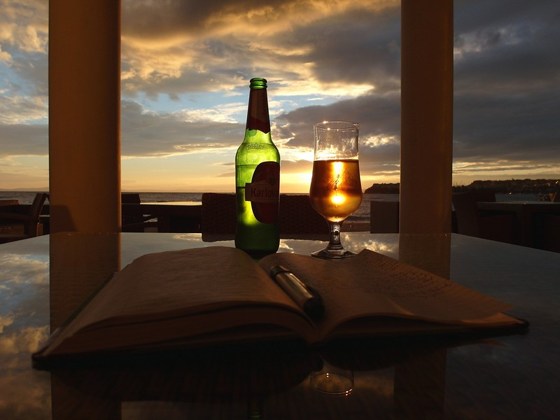 Sitting on the side of the sea, drinking a beer, writing in my diary at sunset and contemplating life..