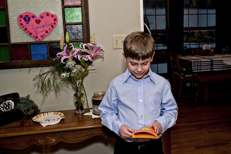 I love this..he took the time to read the card instead of just rushing to see if there was money in it.
